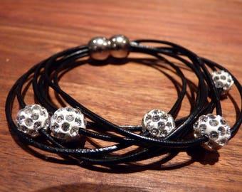 Beautiful bracelet leather and white glitter beads