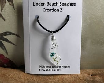 White seaglass on black leather necklace, glitter flower pendant, one of a kind beach glass necklace, blue flower pendant, wire wrapped