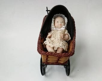Vintage Miniature Solid Porcelain Baby Doll and Carriage