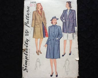 Simplicity pattern 3499. Vintage 1940 misses' reversible or unlined coat with detachable hood. Two piece raglan sleeves, patch pockets.