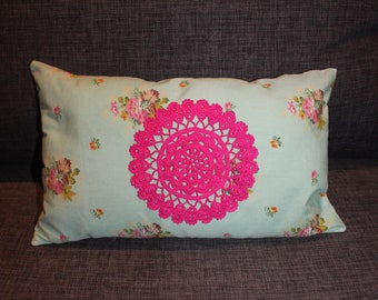 flower with a doily fuchsia fabric cushion