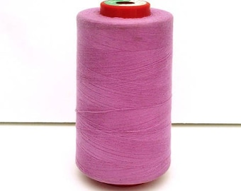 Cone of sewing thread pink poly-cotton