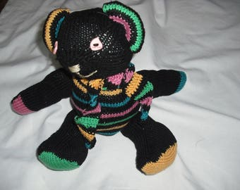 small multicolor bear made with needles in bright colors