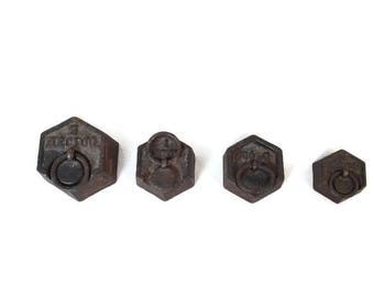 set of 4 vintage french cast iron weights