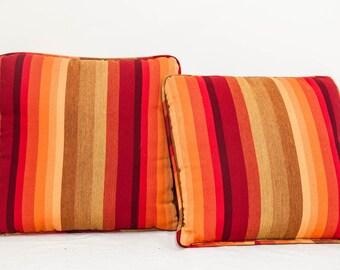 Two 16x16 striped sunbrella decorative pillows