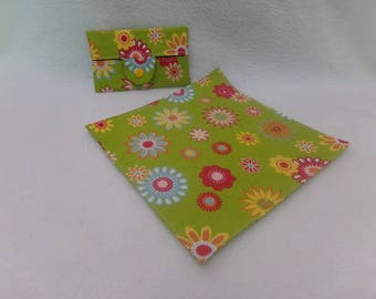 Case and its matching tissue tissue flowers green background