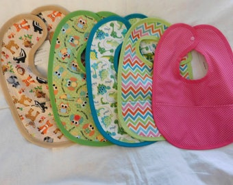 NEW REVERSIBLE BABY Bibs --  waterproof bibs with pocket to catch food  --  Snaps in the back