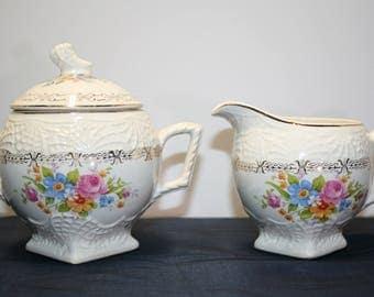 Sugar & creamer from Sebring, OH; National Brotherhood of Operative Potters; Union Made; USA; Royal China