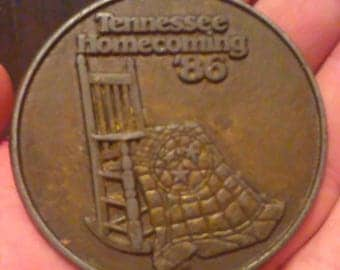 Tennessee Homecoming '86 brass belt buckle