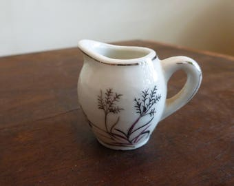 Made in Japan small white ceramic pitcher