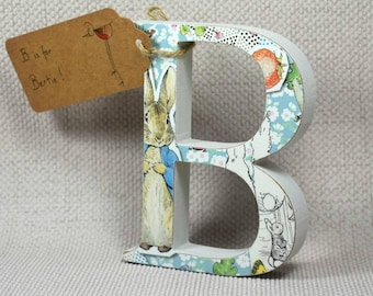 Free Standing Wooden Nursery Letters, with a Peter Rabbit Theme. 13cm Height