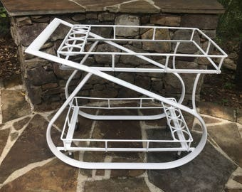 White metal outdoor bar cart. Mod design