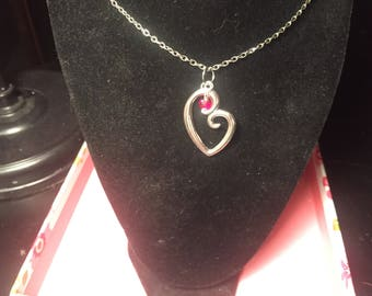 Heart with red bead accent