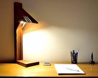 Lamp in oiled massive teak.