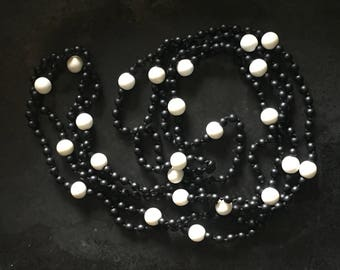 Extra long black and white necklace of matte glass, graphic, striking fashion