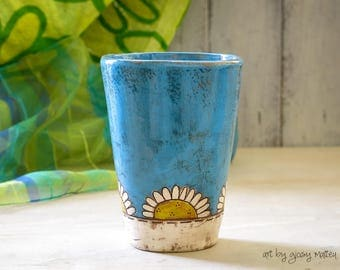 Blue ceramic glass with daisies