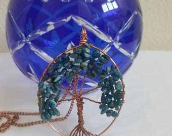 Copper wire wrapped apatite tree of life pendant strung on a copper chain