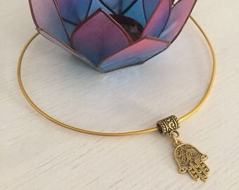 Rigid golden choker with hand of fatima hamsa charm