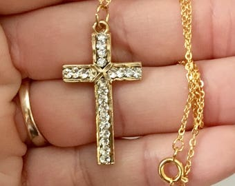 Vintage cross necklace, 1 1/4 inch long gold plated cross with CZ gemstones and comes with an 18 inch gold link chain.
