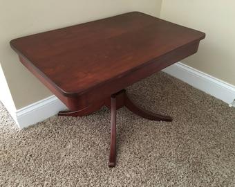 Beautifully restored mahogany coffee table.