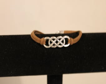 interlocking rings on a brown leather