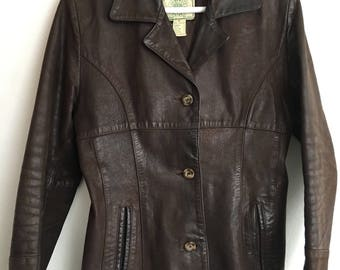Brown strong leather jacket , very good leather woman size medium .