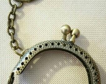 clasp bronze metal wallet