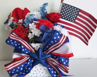Star Themed Silk Flower Arrangement featuring an American Flag and a Handmade Bow