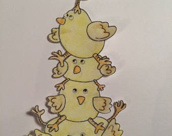 Chicks cut out painted with watercolors