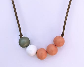 grey, white and salmon pink hand painted wooden bead necklace
