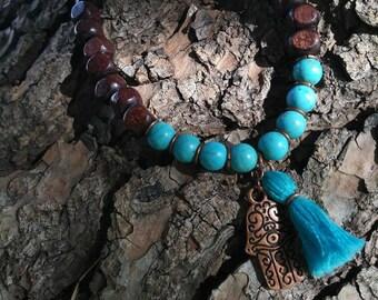 Adjustable howlite and wood hamsa bracelet
