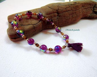 Purple bracelet and tassel