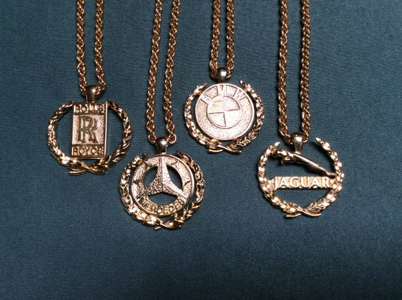 Vintage gold plated medallions krugerrand bmw mercedes jaguar like this item aloadofball Choice Image