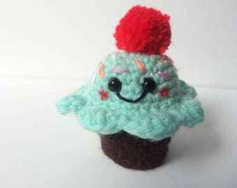 Mint and chocolate crocheted amigurumi crocheted cupcake with sprinkles and a cherry pom pom
