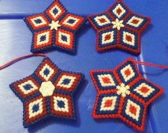 4 double sided red white and blue plastic canvas sewn Christmas star ornaments