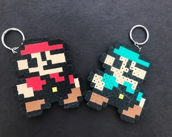 Mario and Luigi keychains and Princess Peach magnet