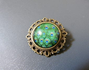 Baroque brooch cabochon green and blue peacock feathers