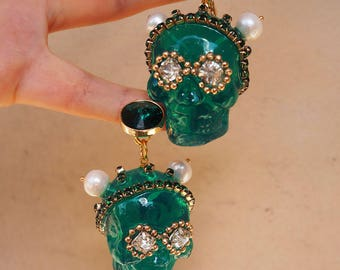 Dark-green skull earrings