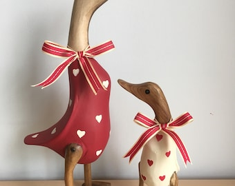 Red and cream duck and duckling