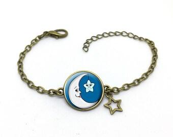 """Bracelet """" lune et étoile  """", bleu et blanc image sous cabochon résine ,monture couleur bronze,ref b 58"""