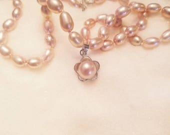 Real rice pearl necklace. Grade AAA pink sterling silver clasps