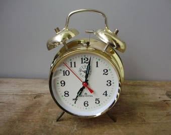 "Vintage,gold-colored""Helvetia"" Table/Alarm Clock,windup clock,working condition"