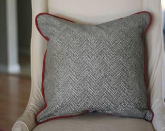 Grey chenille chevron/herringbone pillow with red welt.