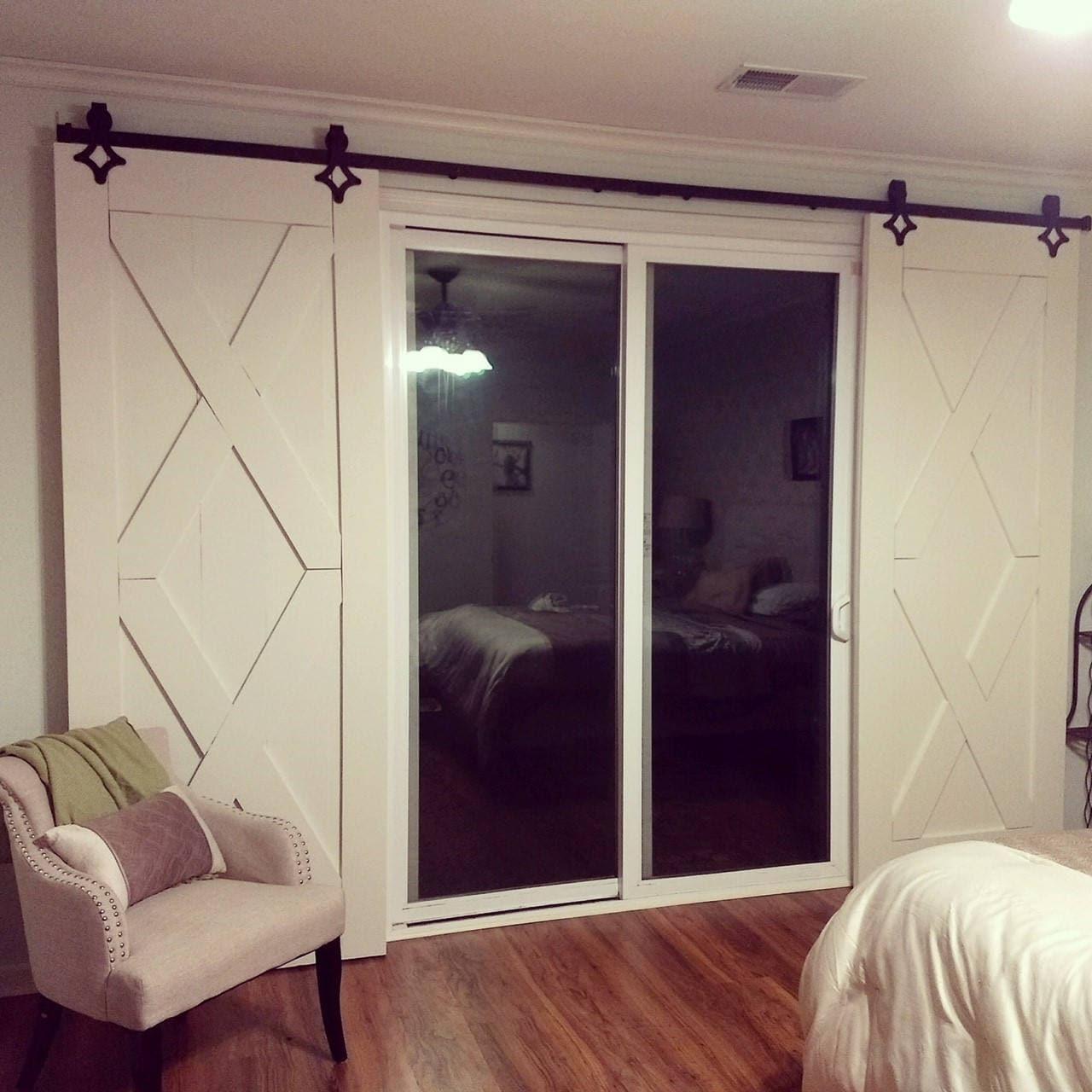 Double x rustic barn door in white door wood door for Sliding glass door styles
