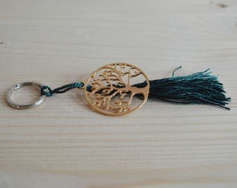 Gold plated tree keychain with dark green tassel