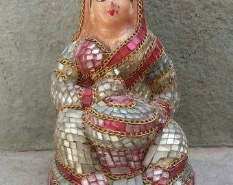 A lovely vintage temple souvenir clay doll embellished with glass work.