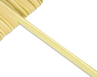 1m elastic piping band yellow uni