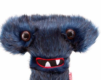 Alphabite T is an off-the-wall, potty-mouthed, faux fur  Custom Monster Plush Toy