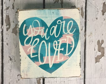 You are Loved Distressed Wooden Sign with blues, pink, and white, perfect for a nursery, child's room or gender reveal party!