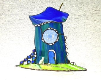 """Blue stained glass Tiffany """"Zoubib"""" village house."""